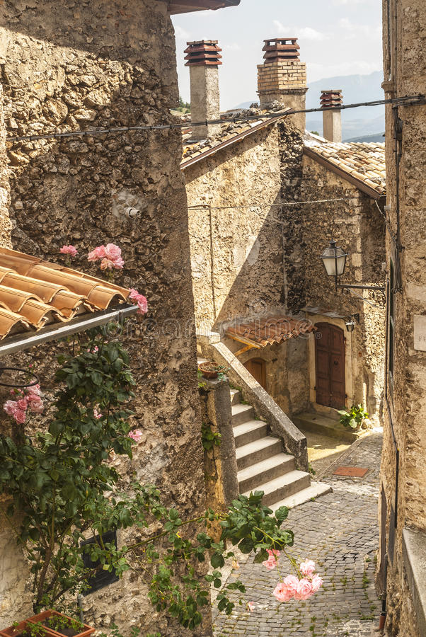 Calascio (Abruzzi). Calascio (L'Aquila, Abruzzi, Italy) - Houses with plants and flowers in the old village royalty free stock images
