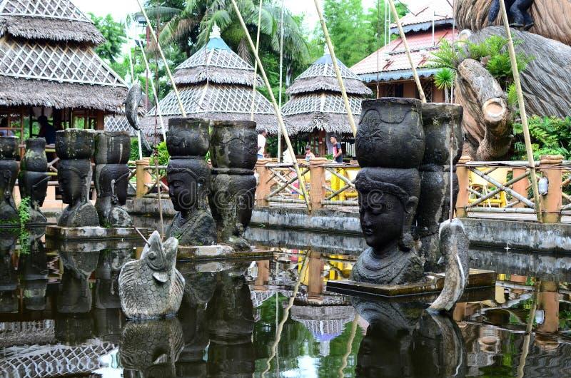 Giant stone buddha decorates an Asian aquatic jungle theme park. Calauan Laguna, Philippines - August 28, 2016: giant stone buddha decorates an Asian aquatic royalty free stock image