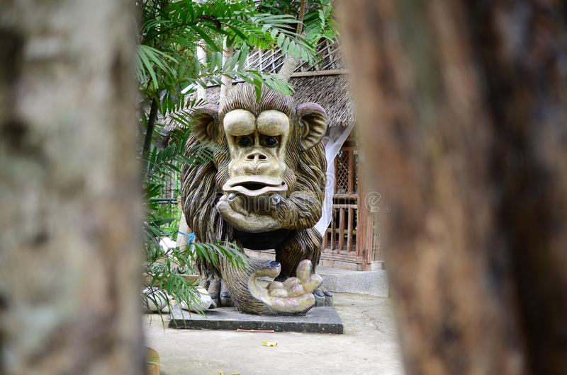 Huge concrete carved monkey statue in an Asian aquatic jungle theme park royalty free stock images