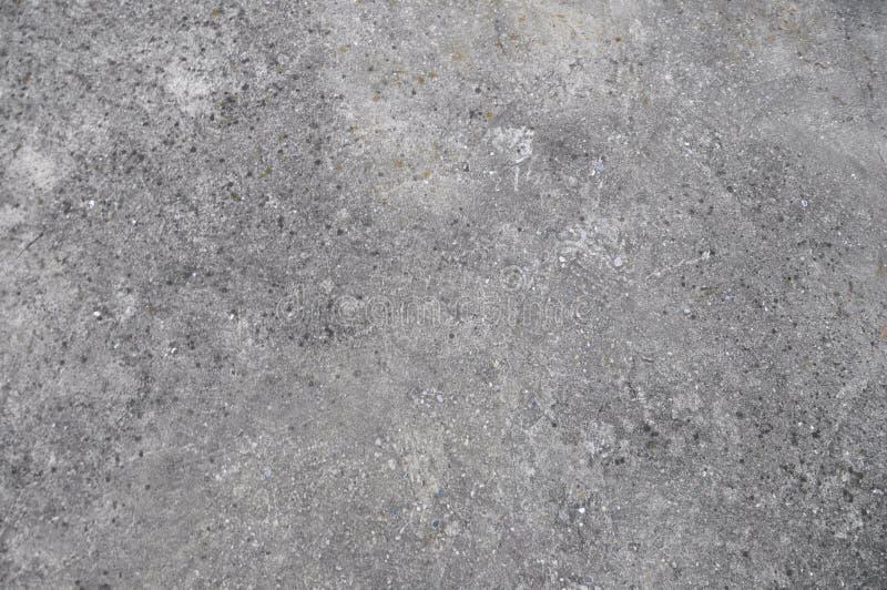 Calcestruzzo ruvido scuro rurale dell'asfalto della pavimentazione di strada Vista superiore di struttura piana senza cuciture de fotografia stock