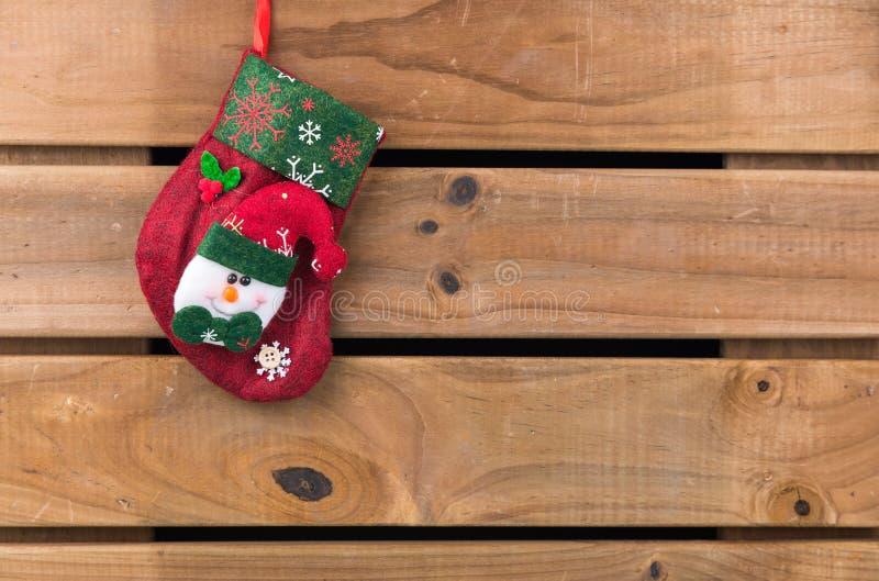 Calcetín de la Navidad con el muñeco de nieve imagen de archivo