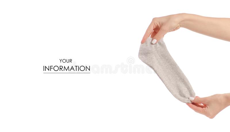 Calcetines en el modelo beige blanco de las manos foto de archivo libre de regalías