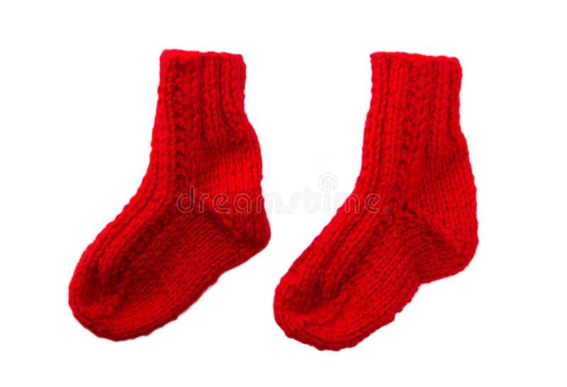 calcetines hechos a mano rojos aislados para la navidad fotografa de archivo