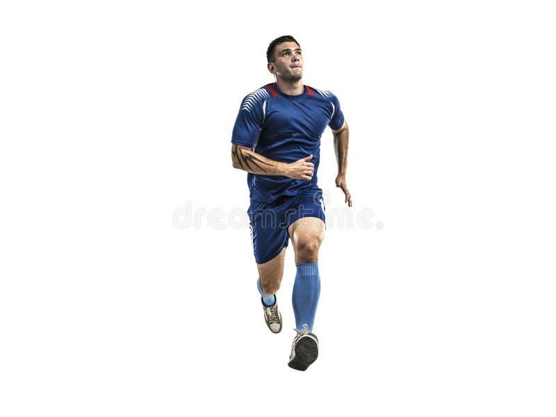 Calciatore in uniforme blu che corre sull'isolamento bianco fotografia stock