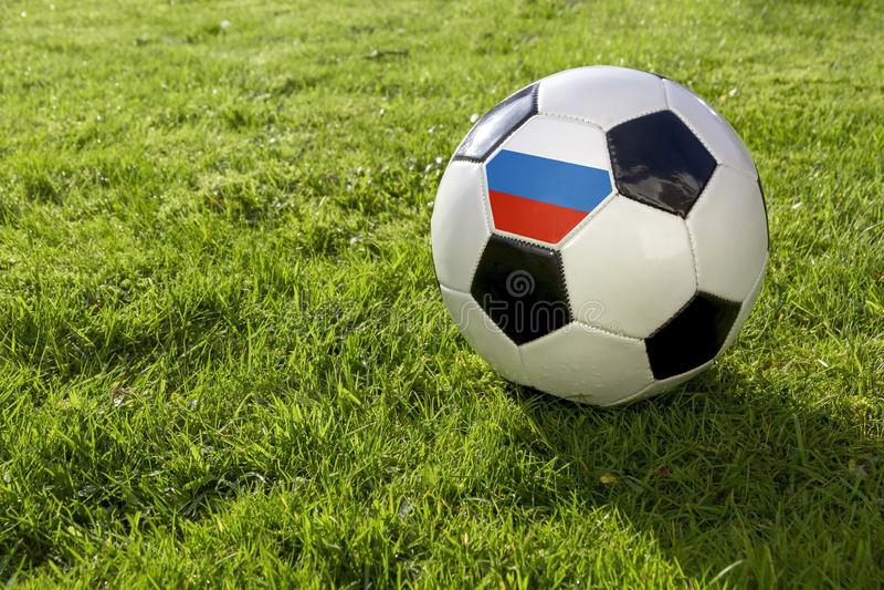 Calcio con la bandiera fotografia stock libera da diritti