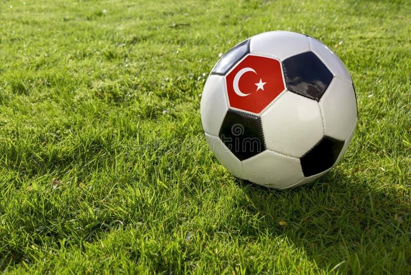 Calcio con la bandiera fotografia stock