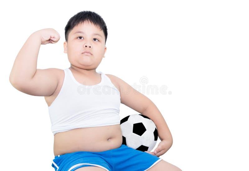 Calcio grasso della tenuta del ragazzo immagine stock libera da diritti