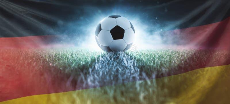 Calcio sul prato inglese dello stadio con la bandiera della Germania fotografia stock