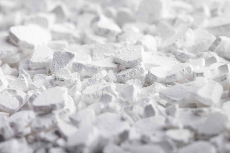 Calcium Chloride Flakes. Calcium chloride (CaCl2) flakes. Common applications include brine for refrigeration plants, ice and dust control on roads, and stock photos