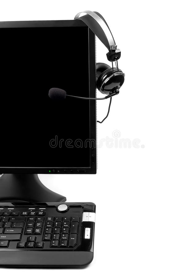 Calcolatore con la cuffia avricolare di VOIP immagine stock libera da diritti