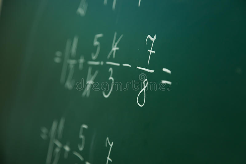 Calcualting with fractions royalty free stock photo