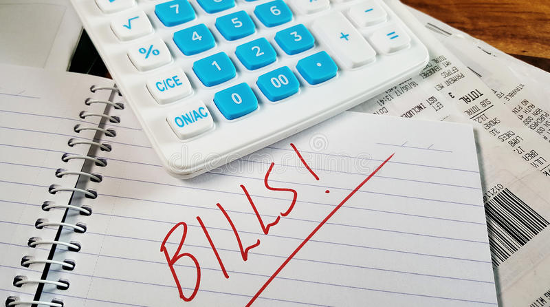 Calcukating das Budget stockbild