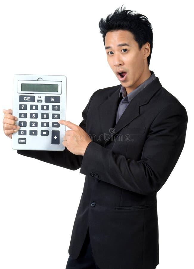 Calculadora amedrontada Made da posse do homem de negócio foto de stock