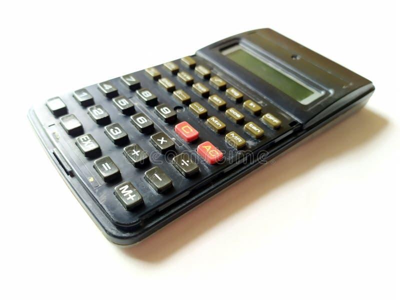Calculadora científica negra en el fondo blanco imagen de archivo