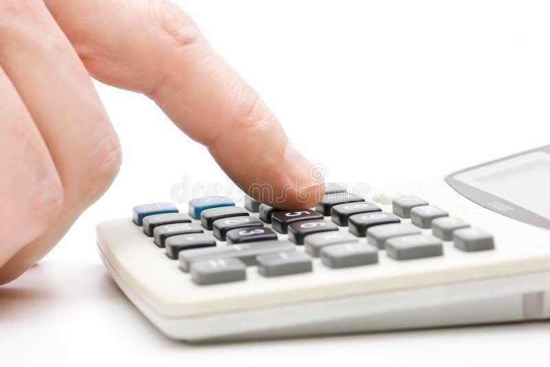 Calculadora com dedo foto de stock royalty free