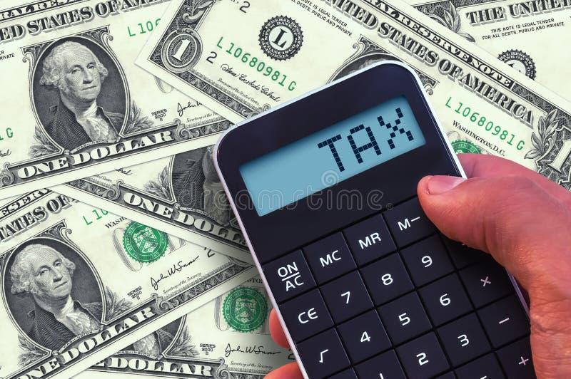 Calculadora com o imposto da palavra imagem de stock royalty free