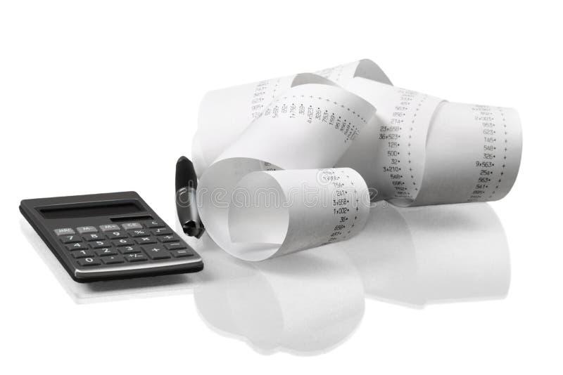 Calculadora con de cinta de papel rodada para arriba imágenes de archivo libres de regalías