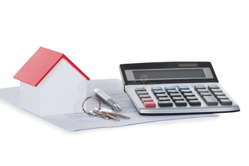 Calculadora con el modelo And Documents de la casa fotos de archivo libres de regalías