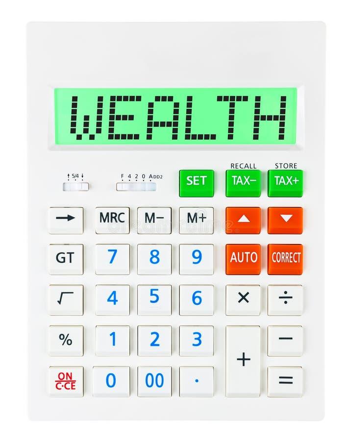 Calculadora con RIQUEZA foto de archivo