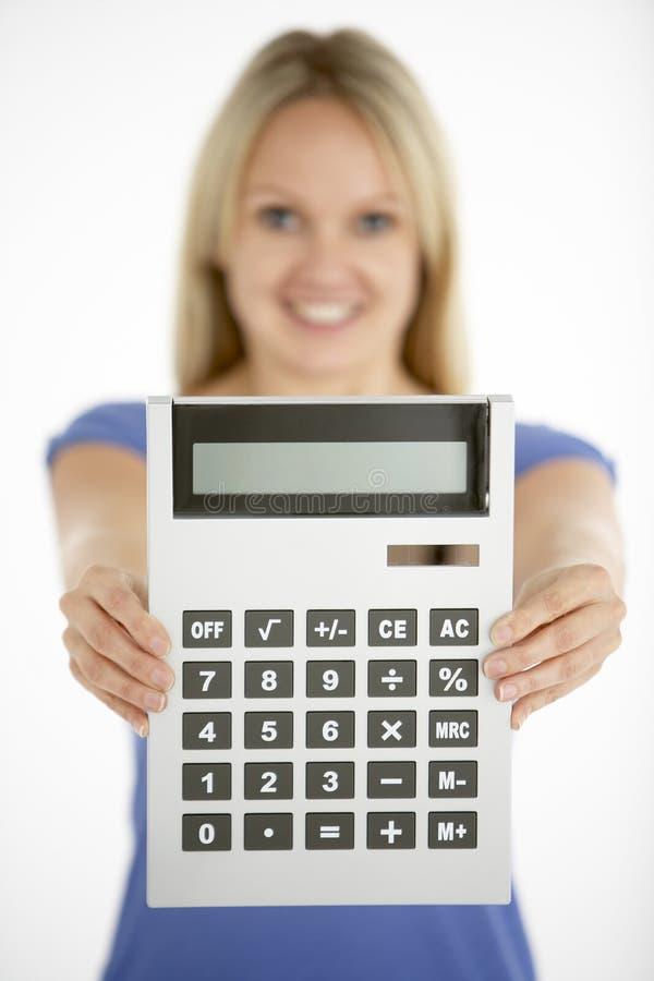 Calculadora da terra arrendada da mulher fotografia de stock royalty free