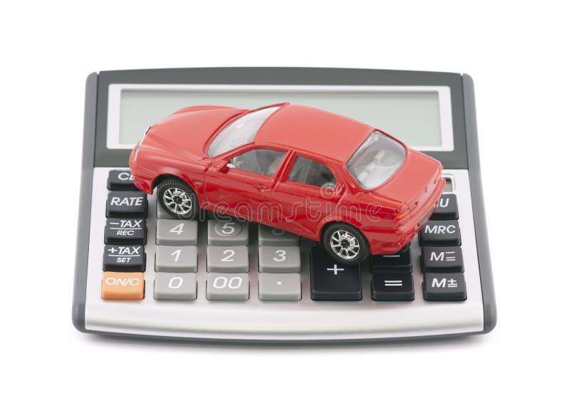 Calculadora e carro vermelho do brinquedo fotografia de stock