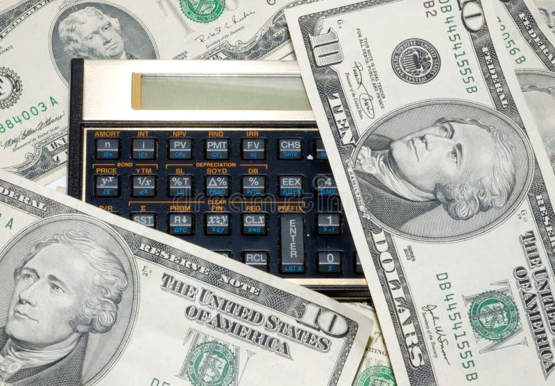 Calculadora e dinheiro fotos de stock