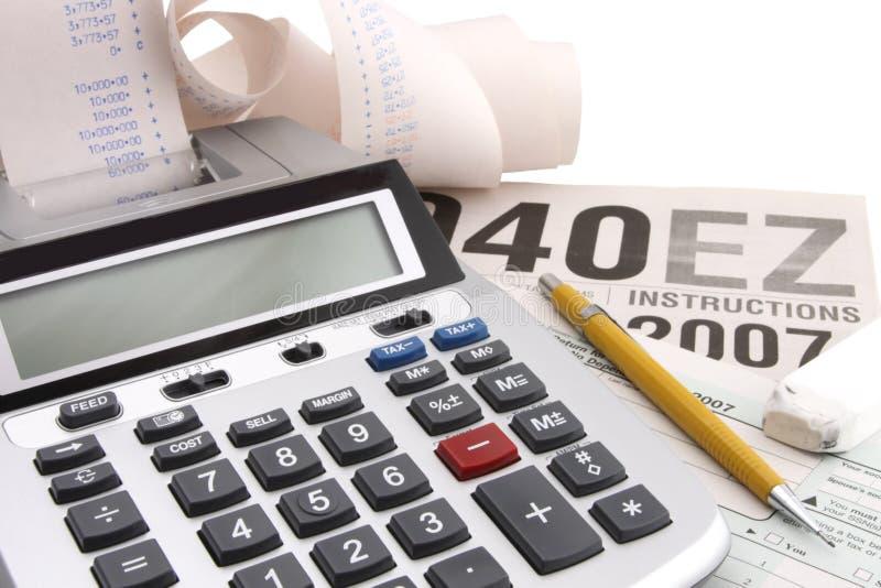 Calculadora e estação do imposto fotografia de stock