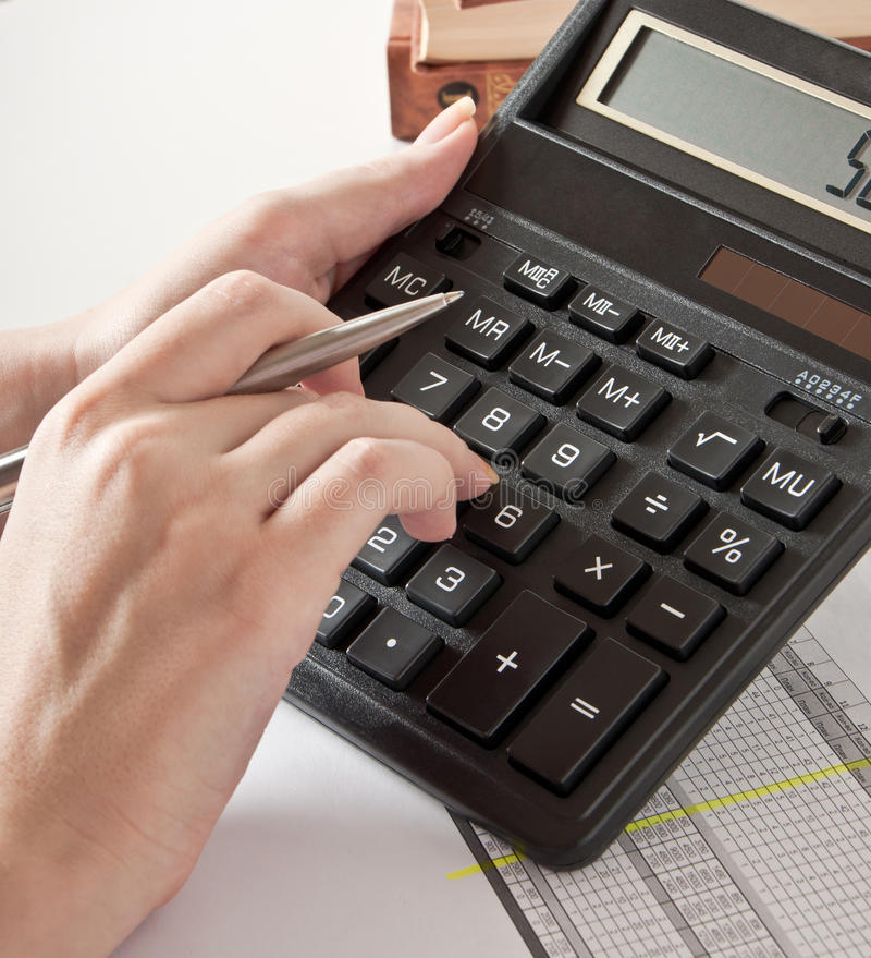 Calculadora e o relatório financeiro imagem de stock royalty free