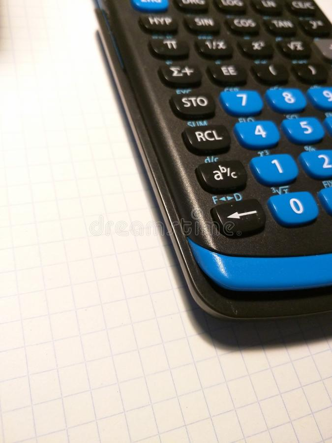 Calculadora en el papel foto de archivo libre de regalías