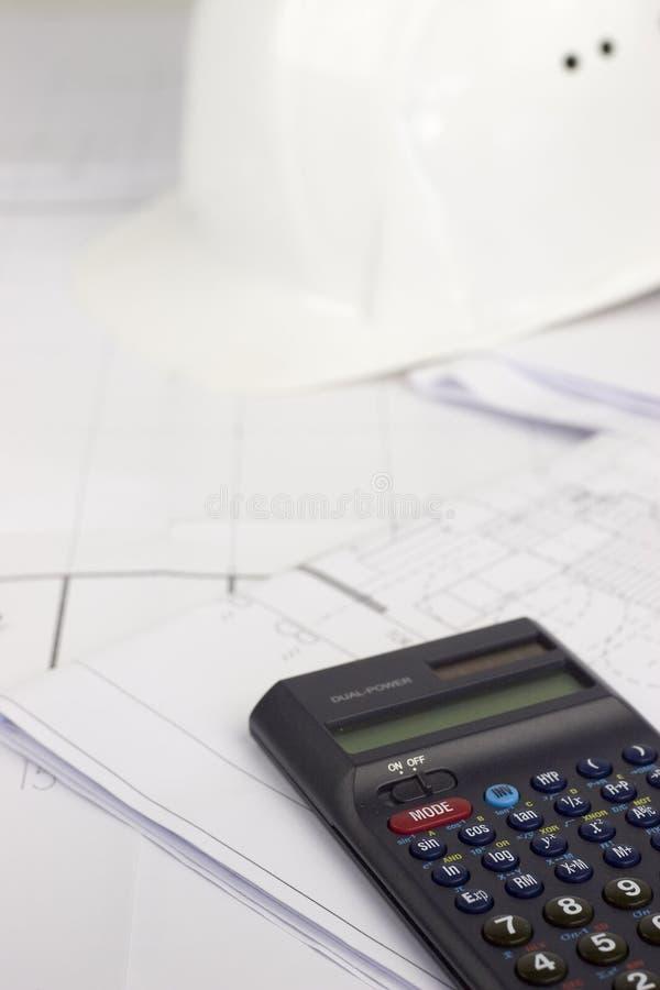 Calculadora en plan de la construcción imagen de archivo