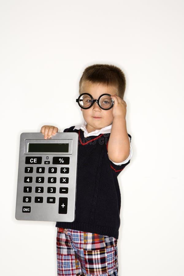 Calculadora masculina de la explotación agrícola. fotografía de archivo libre de regalías