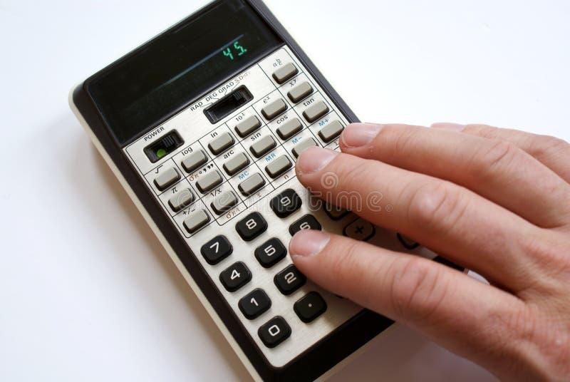 Calculadora retro e mão fotografia de stock