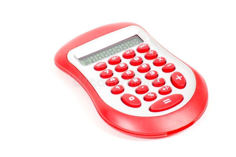 Calculadora vermelha no fundo branco imagens de stock royalty free
