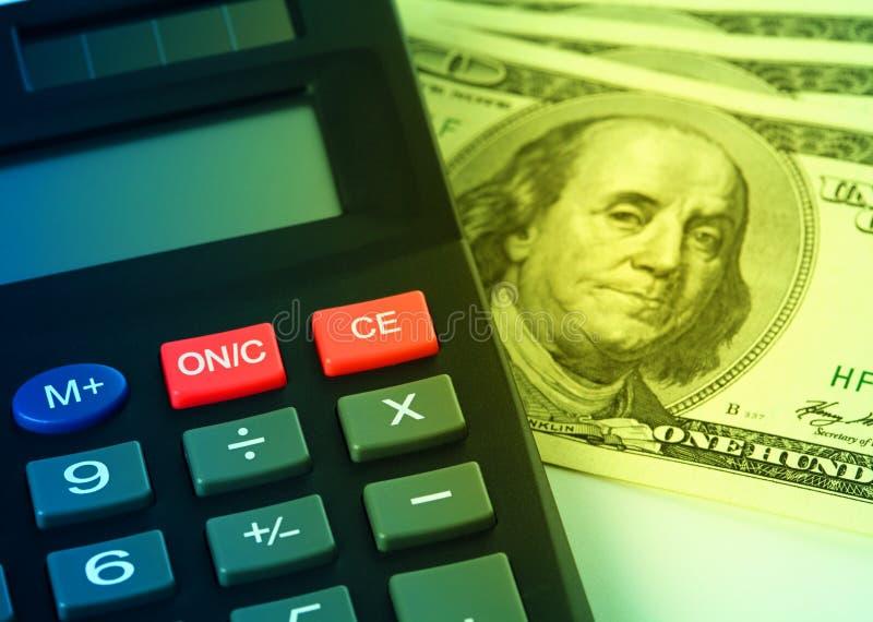 Calculadora y dinero - concepto de estadísticas foto de archivo
