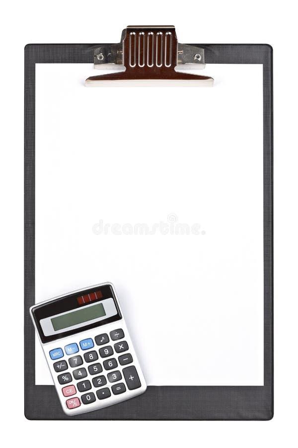 Calculadora y sujetapapeles foto de archivo