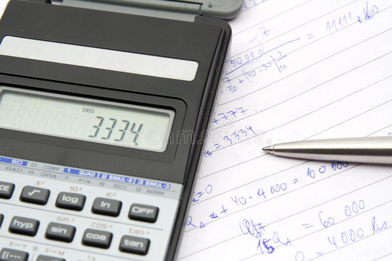 Calculating. Student calculate economical example - calculator, pen, commonplace book royalty free stock photography