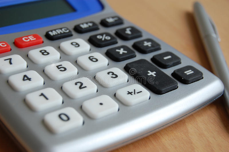 Calculating. Annual profit or losses stock photos