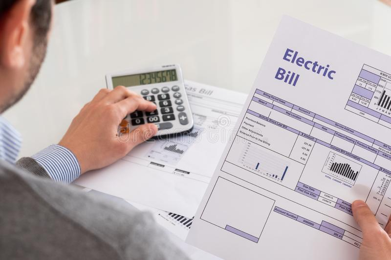 Calculating energy efficiency and energy bill papers royalty free stock images