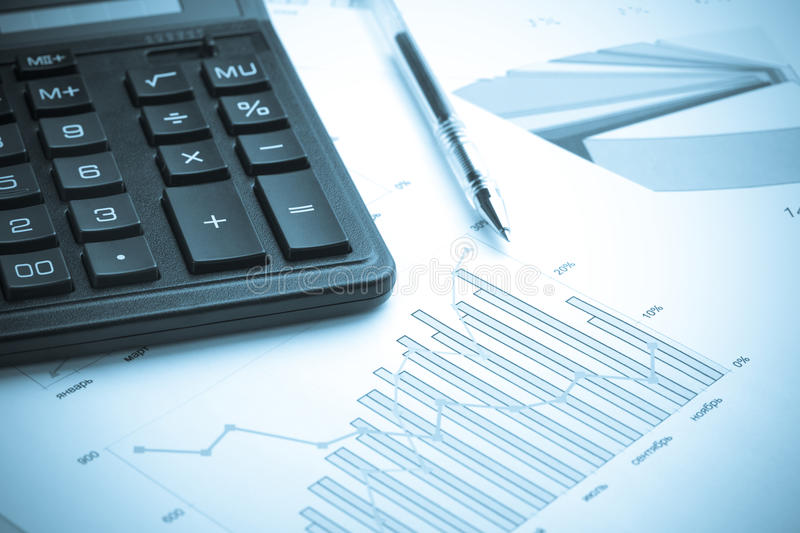 Calculating finances.Cold tone. stock photography