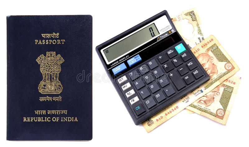 Calculating foreign trip expenses. Indian passport with money and calculator isolated on white background royalty free stock photos