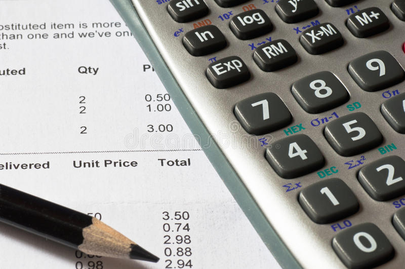 Calculating sales. Calculator and an accountants spreadsheet stock photography