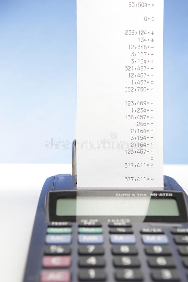 Calculation. Desktop Calculator paper tape, closeup on white background royalty free stock photos