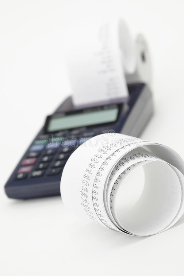 Calculation. Desktop Calculator paper tape, closeup on white background royalty free stock photo