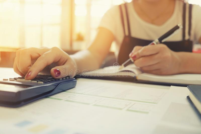 Calculation of business cropped shot of woman using calculator w stock images