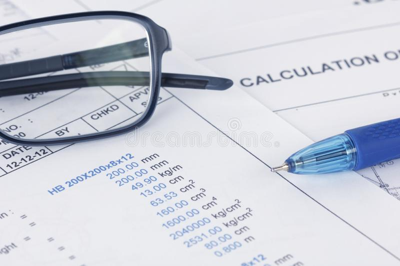 Calculation document with pen and eyeglasses royalty free stock image