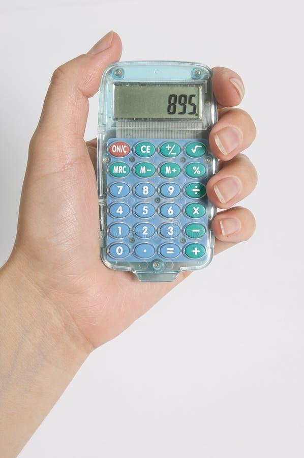 Calculator. Figuring costs on calculator stock photos