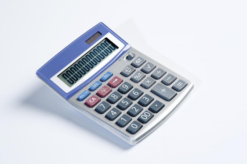 Calculator. In a white background stock photography