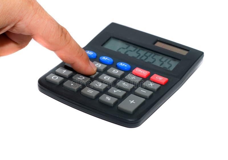Calculator. Man finger on the calculator royalty free stock photos