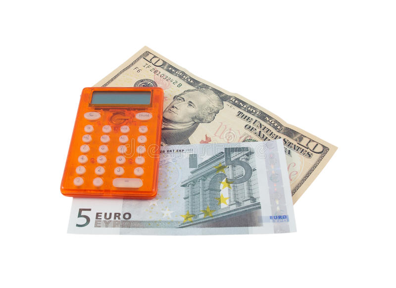 Calculator with 5 euro and 10 dollar banknotes. Calculator with five euro and ten dollar banknotes isolated on a white background royalty free stock photos