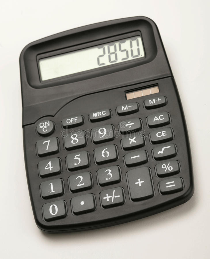 Calculator. Closeup of black calculator on white background stock photography
